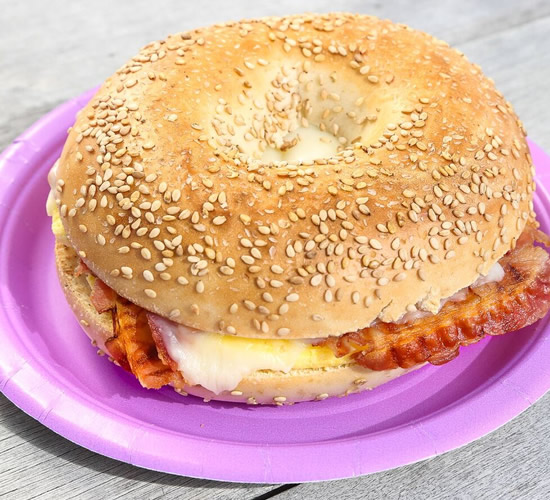 egg and bacon sandwich on sesame bagel