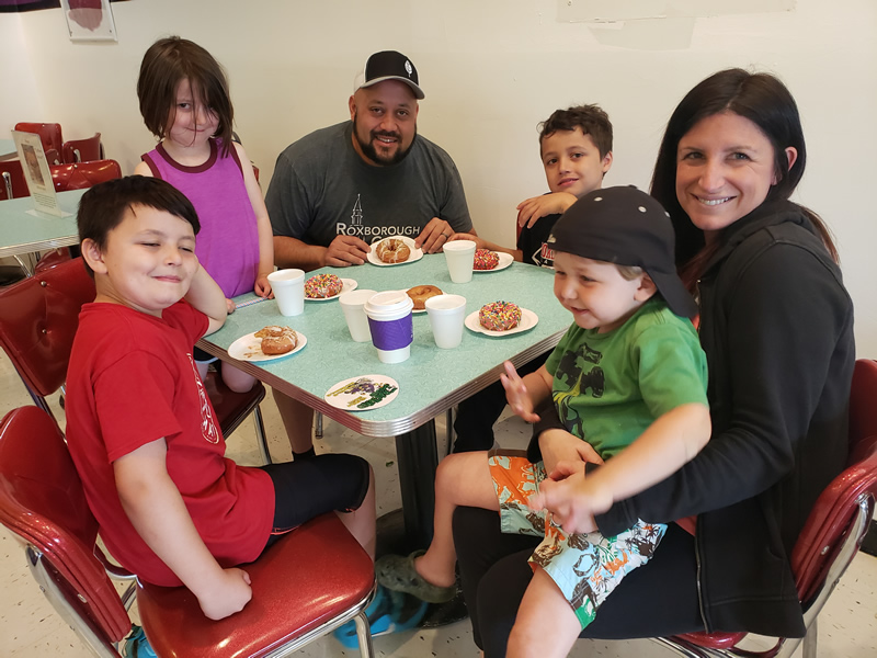 Family enjoying Fractured Prune donuts