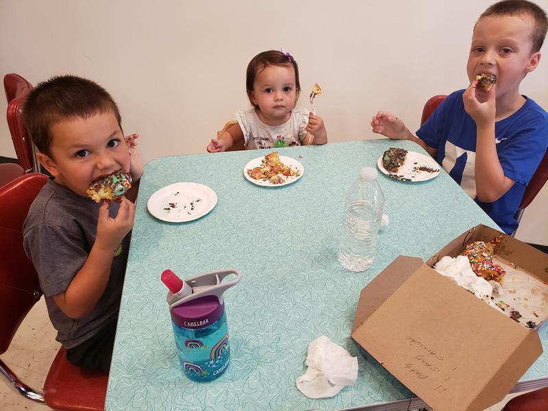 Children eating donuts