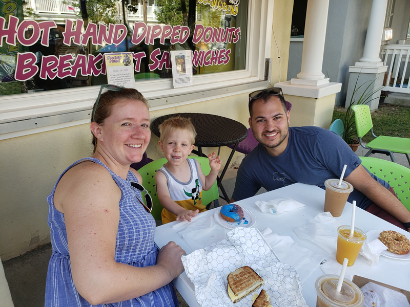 Ocean City Downtown location: young family enjoying donuts