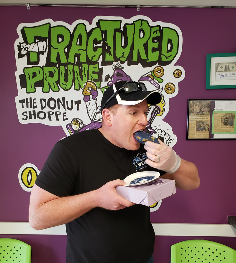 employee eating a donut