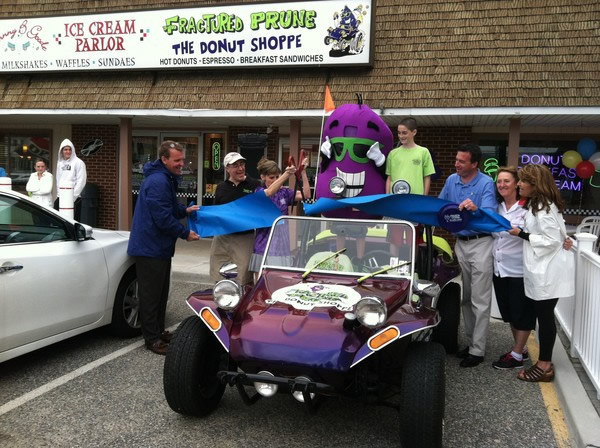 Fractured Prune mascot and buggy